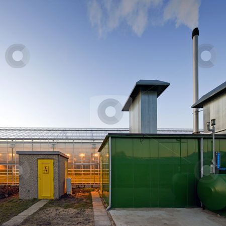 Glasshouse power facility stock photo, The diesel fuelled power generator supplying a huge glasshouse with the needed electricity for illumination and heating by Corepics VOF
