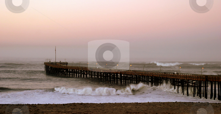 Ocean Wave Storm Pier stock photo, Ocean waves throughout at storm crashing into a wooden pier. by Henrik Lehnerer