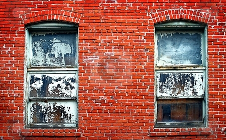 Old Windows Bricks stock photo, Two old windows in a rustic red brick wall. by Henrik Lehnerer