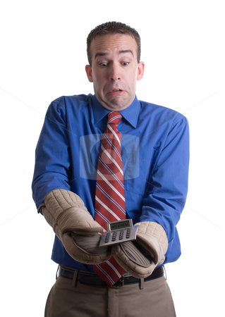 Hot Investment Concept stock photo, Concept image of a young businessman using oven mitts to handle his hot investment, isolated against a white background by Richard Nelson
