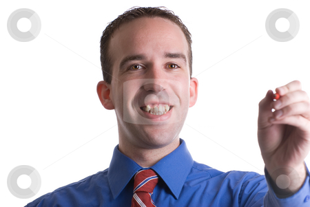 Using A Marker stock photo, A man wearing a blue shirt and tie is using a marker, isolated against a white background by Richard Nelson