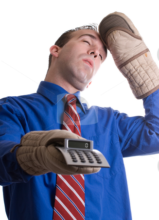 Fainting Banker stock photo, A young banker is fainting at the calculations he did on his calculator by Richard Nelson