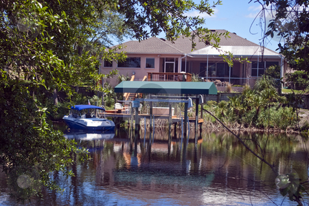 Florida Home on Canal stock photo, Typical Florida home on canal complete with docki and boat. by Steve Carroll