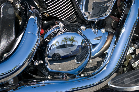 Reflections in Chrome stock photo, Reflection of custom painted car in motorcycles chrome motor parts by Steve Carroll
