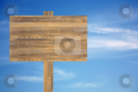 Cloudy sky with old wooden sign stock photo, Beautiful blue heavenly and soft cloudy sky with blank wooden sign by Stacy Barnett