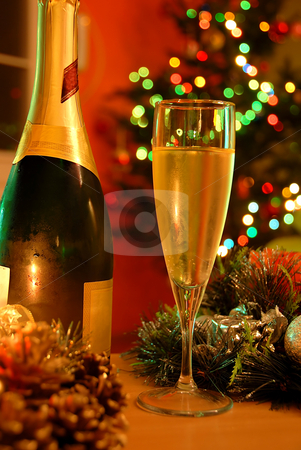 New year champagne stock photo, Glass of champagne and bottle over new year tree by Julija Sapic