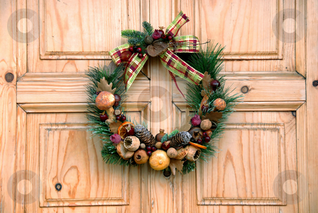 Christmas door decoration stock photo, Christmas wreath on wooden door outdoor closeup by Julija Sapic