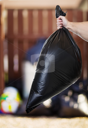Garbage day stock photo, A Man taking out the trash in the back alley by Steve Mcsweeny
