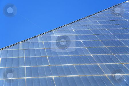 Glass building stock photo, Detail of pyramid shaped glass building and blue sky by Gjermund Alsos