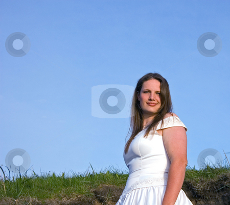 Attractive Brunette Bride Against Blue Sky stock photo, This attractive brunette natural looking young bride is set against a bright blue sky. by Valerie Garner
