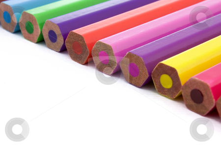 Colored pencils stock photo, Straight line of colored pencils on a white background by Gabriele Mesaglio