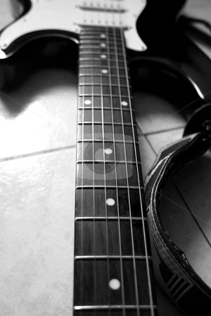 Guitar stock photo, Black and white close up of neck of guitar by Fabio Alcini