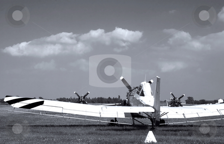 Old plane stock photo, Old plane seen from behind, targeting blue sky, black and white by Fabio Alcini