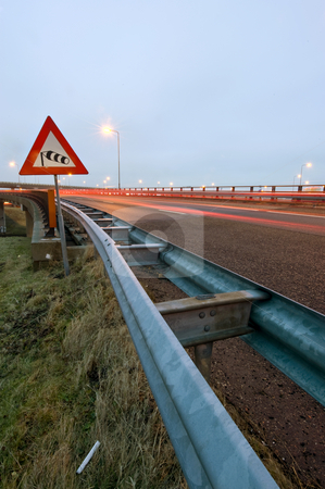 Windvane warning sign stock photo, The windvane on a sign, warning the traffic for heavy winds on the motorway overpass by Corepics VOF