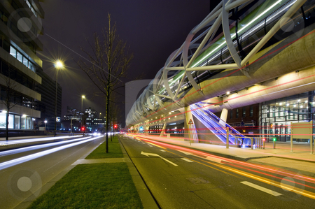 Futuristic tram tube stock photo, The futuristic elevated tram line in the Hague and underlying road by Corepics VOF
