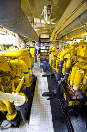Tugboat's Engine Room stock photo, The engine room of a tugboat, with the various diesel engines for propulsion by Corepics VOF