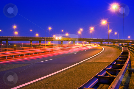Motorway at night stock photo, Cars breaking on an overpass of a motorway at night by Corepics VOF