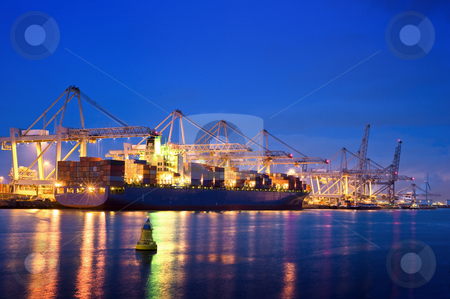 Container terminal at night stock photo, The activity of loading and unloading of huge container ships at the world's biggest and busiest container harbor in Rotterdam by Corepics VOF