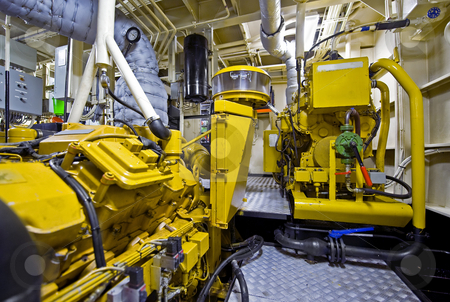 Tugboat engine room stock photo, The engine room of a tugboat, used for firefighting tasks by Corepics VOF