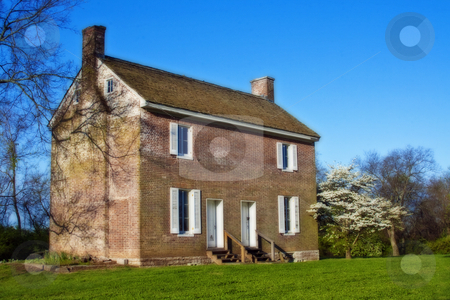 Landscape of Old Southern House stock photo, Landscape of old southern house in spring with blue sky and flowering trees by Dennis Crumrin