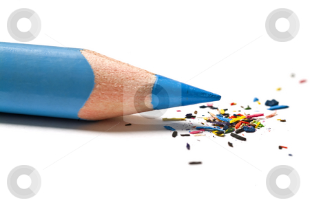Blue pencil and shavings stock photo, Blue pencil and multi colored shavings isolated on white by Noam Armonn
