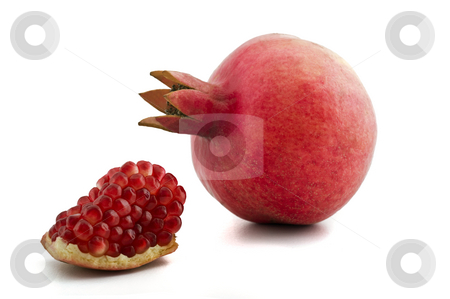 Pomegranate isolated stock photo, Whole and slice of pomegranate isolated on white by Noam Armonn
