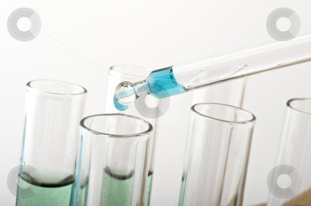 Science lab stock photo, Blue drop from a pipette in a science lab by Noam Armonn