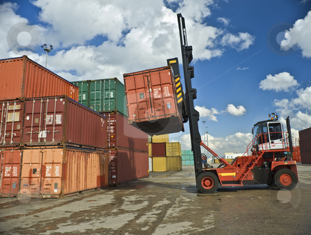 Containers staking stock photo, Containers forklift at work by Noam Armonn