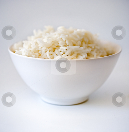 Rice bowl 3 stock photo, Rice bowl in shallow depth of field  on white by Noam Armonn