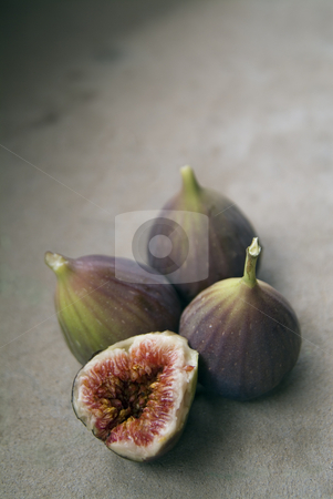 Purple figs stock photo, Three figs and a slice by Noam Armonn
