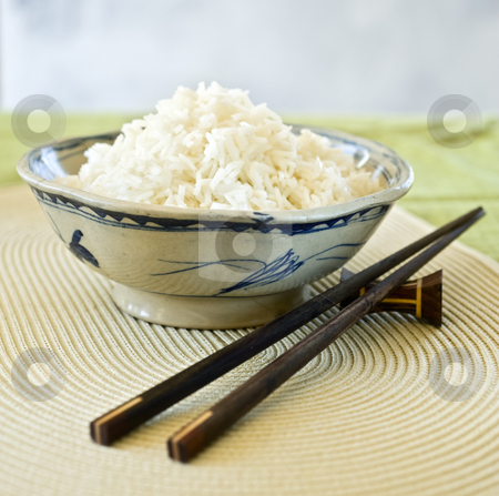 Bowls of rice stock photo, Plain ricein an old chienes ceramic bowl by Noam Armonn