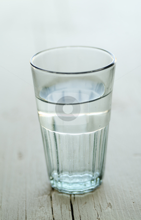 Glass of water stock photo, Glass of water on a white wooden surface with SDF by Noam Armonn