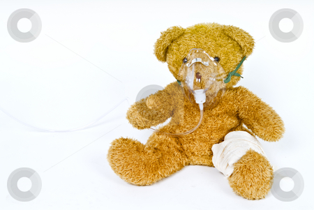 Wounded teddy stock photo, Teddy bear with oxygen mask and bandege by Noam Armonn