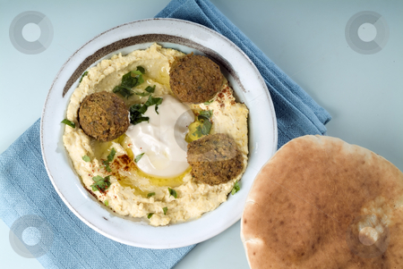 Hummus and Falafel stock photo, Falafel balls with hummus, pita and a tahini sauce from above. by Noam Armonn