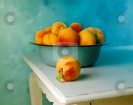 Peaches in blue old bowl stock photo, Group of Peaches in blue old bowl and one peach on the white old table by Noam Armonn