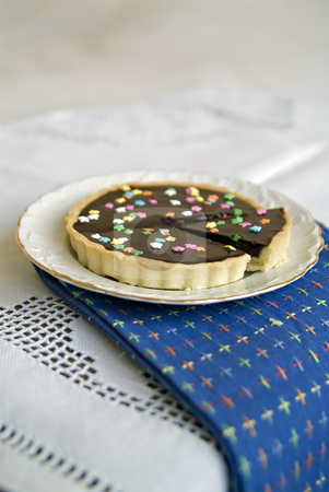 Chocolate Tart stock photo, Chocolate Tart with colorful star candies by Noam Armonn