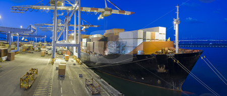 Cargo ship by night stock photo, Cargo ship at dock by night panorama by Noam Armonn
