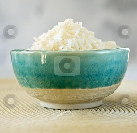 Bowl of rice stock photo, Plain rice in a blue ceramic bowl by Noam Armonn