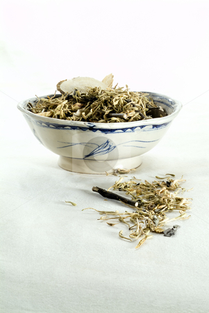 Medical chinese herbs stock photo, Medical chinese herbs in an ancient Chinese ceramic bowl. by Noam Armonn