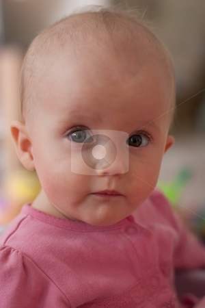 Fun time stock photo, Cute little caucasian baby girl sitting and playing. by Mariusz Jurgielewicz