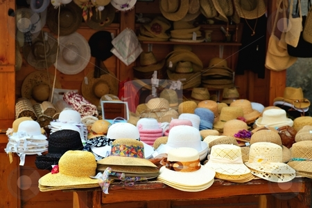 Straw hats stock photo, Straw hats on a market in a small city by Juraj Kovacik