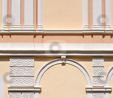 Arc and columns stock photo, Detail of a facade of a historical building with white columns by Juraj Kovacik