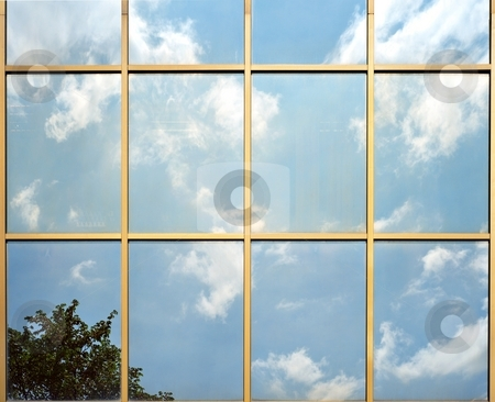 Glass facade reflection stock photo, Glass facade reflection of blue sky with clouds by Juraj Kovacik