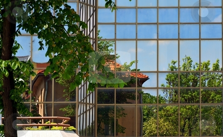 Old in new stock photo, Sky, tree and a house with red roof reflection in modern glass facade by Juraj Kovacik