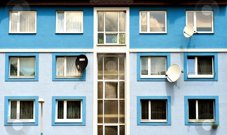Satelite antennas stock photo, Satellite antennas for TV receiving on a blue facade by Juraj Kovacik