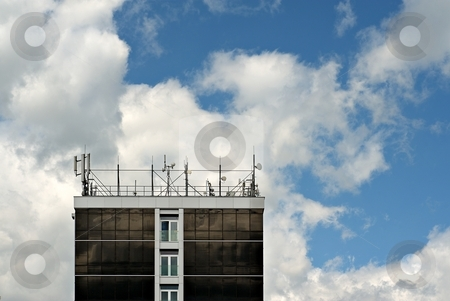 Antennas on roof stock photo, Roof of a building filled with antennas and communication devices. by Juraj Kovacik