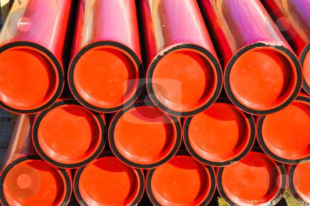 Red tubes stock photo, Sunlight shining on red tubes by Jaime Pharr