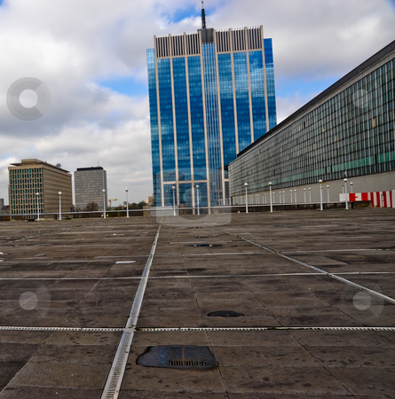 Office building  stock photo, Office building with square in the foreground by Jaime Pharr