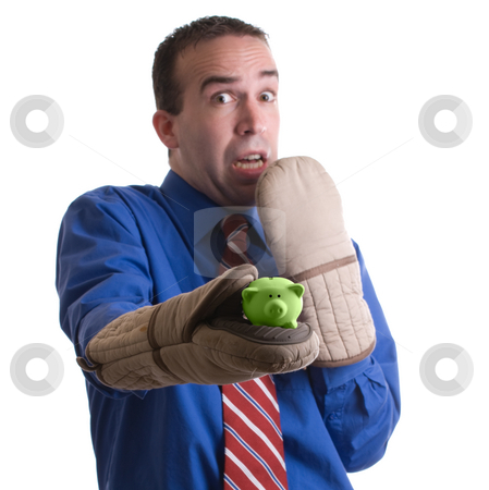 Risky Investment stock photo, Concept image a risky investment featuring a businessman holding a small piggy bank with oven mitts, isolated against a white background by Richard Nelson