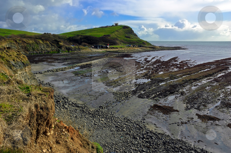 Kimmeridge Bay stock photo, Pebbles and cliffs at Kimmeridge bay Dorset by Robert Ford